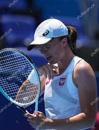 (210724) - TOKYO, July 24, 2021 (Xinhua) - Iga Swiatek of Poland reacts during the Tokyo 2020 tennis women's singles first round match between Iga Swiatek of Poland and Mona Barthel of Germany in Tokyo, Japan, July 24, 2021.