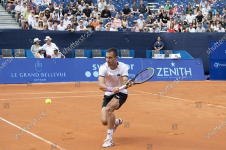 Laslo Djere of Serbia in action against Hugo Gaston of France during the semi final round game at the Swiss Open tennis tournament in Gstaad, Switzerland, 24 July 2021.