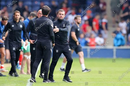 Nathan Jones Manager of Luton Town congratulates Danny Cowley Manager of Portsmouth during the Pre-Season Friendly match between Luton Town and Portsmouth at Kenilworth Road, Luton