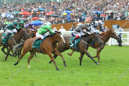 Zain Claudette and Ray Dawson [right] win the Princess Margaret Keenland Stakes at Ascot from Desert Dreamer [near] and Delmona [centre] at Ascot.