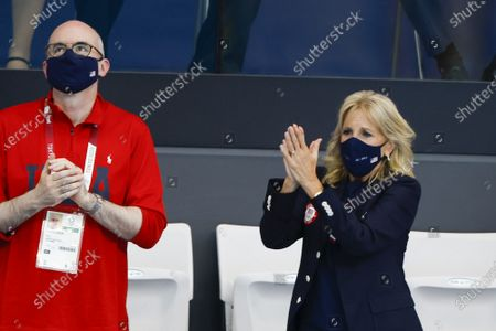 First Lady Jill Biden cheers on the first day of swimming competitions at the Tokyo Aquatics Center, during the Tokyo Summer Olympic Games in Tokyo, Japan, on Saturday July 24, 2021.