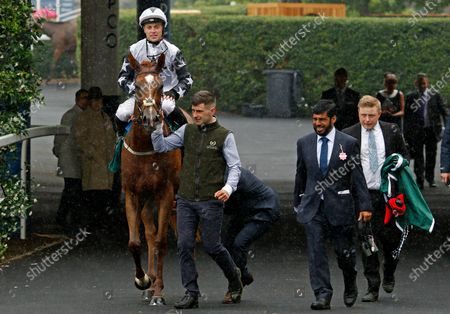Stock Image of ZAIN CLAUDETTE (Ray Dawson) with Ismail Mohammed after The Princess Margaret Keeneland Stakes Ascot