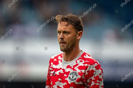 Manchester United midfielder Nemanja Matic (31) warming up before the Pre-Season Friendly match between Queens Park Rangers and Manchester United at the Kiyan Prince Foundation Stadium, London