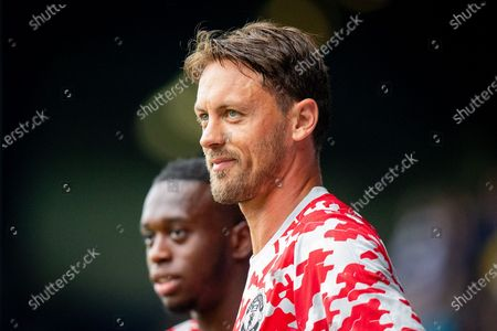 Manchester United defender Aaron Wan-Bissaka (29), Manchester United midfielder Nemanja Matic (31) warming up before the Pre-Season Friendly match between Queens Park Rangers and Manchester United at the Kiyan Prince Foundation Stadium, London