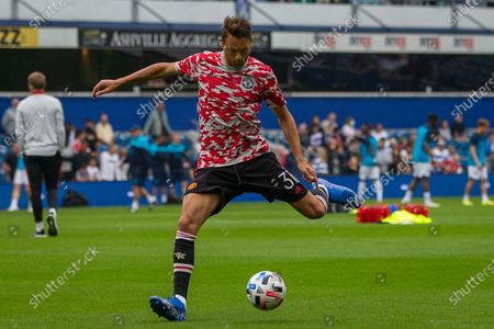 Stock Image of Manchester United midfielder Nemanja Matic (31) warming up before the Pre-Season Friendly match between Queens Park Rangers and Manchester United at the Kiyan Prince Foundation Stadium, London