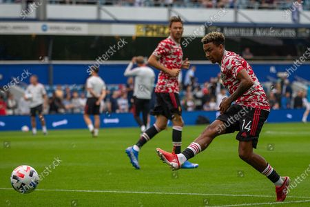 Manchester United midfielder Jesse Lingard (14), warming up before the Pre-Season Friendly match between Queens Park Rangers and Manchester United at the Kiyan Prince Foundation Stadium, London