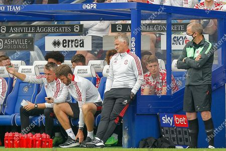 Manchester United first-team coach Kieran McKenna, Manchester United first-team coach Michael Carrick, Manchester United Manager Ole Gunnar Solskjær during the Pre-Season Friendly match between Queens Park Rangers and Manchester United at the Kiyan Prince Foundation Stadium, London