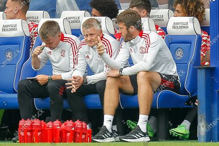 Manchester United first-team coach Kieran McKenna, Manchester United Manager Ole Gunnar Solskjær, Manchester United first-team coach Michael Carrick, during the Pre-Season Friendly match between Queens Park Rangers and Manchester United at the Kiyan Prince Foundation Stadium, London
