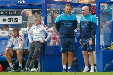 Stock Photo of Manchester United first team coach Michael Carrick, Manchester United Manager Ole Gunnar Solskjær, Queens Park Rangers assistant manager John Eustace, Queens Park Rangers manager Mark Warburton pointing, signalling, gesturing during the Pre-Season Friendly match between Queens Park Rangers and Manchester United at the Kiyan Prince Foundation Stadium, London