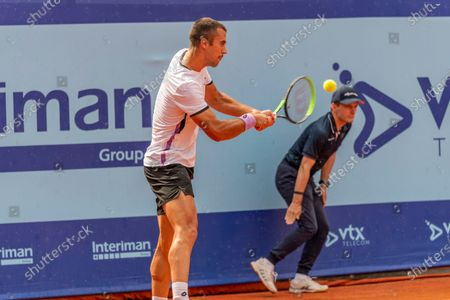 Stock Photo of Gstaad Switzerland, 07/24/2021: Laslo Djere of Serbia is in action during the Gstaad Swiss Open ATP Tour 250 Series 2021 tournament final