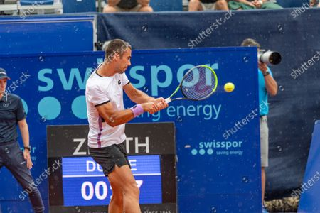 Stock Picture of Gstaad Switzerland, 07/24/2021: Laslo Djere of Serbia is in action during the Gstaad Swiss Open ATP Tour 250 Series 2021 tournament final