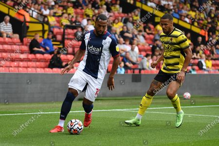 Stock Photo of West Bromwich Albion midfielder Matt Phillips (10) on the ball with Watford Defender William Troost-Ekong (5)  during the Pre-Season Friendly match between Watford and West Bromwich Albion at Vicarage Road, Watford