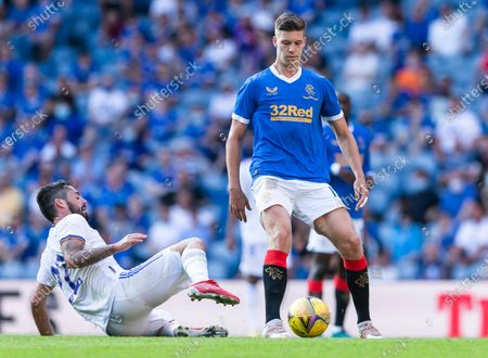Rangers Forward Cedric Itten is tackled by Real Madrid Midfielder Isco