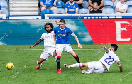 Stock Image of Rangers Forward Scott Wright is fouled by Real Madrid Defender Marcelo and Isco