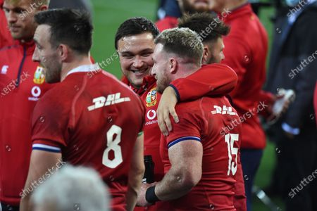 Jamie George hugs Stuart Hogg - British & Irish Lions players following an historic 17-22 victory over the Springboks in the 1st Test match of three in the series.
