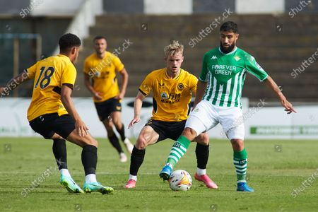 Perry of Wolves and Nabil Fekir of Real Betis in action during the football friendly match played between Real Betis Balompie and Wolveshampton Wanderers FC at Municipal La Linea Stadium on July 24, 2021 in Cadiz, Spain.