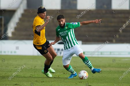 Raul Jimenez of Wolves and Nabil Fekir of Real Betis in action during the football friendly match played between Real Betis Balompie and Wolveshampton Wanderers FC at Municipal La Linea Stadium on July 24, 2021 in Cadiz, Spain.