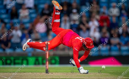 Welsh Fire's Jonny Bairstow attempts to take a ball for a run out against the Northern Chargers.