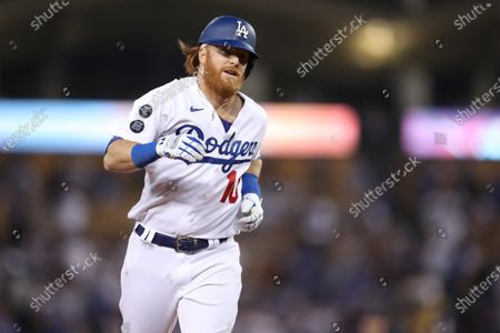Los Angeles Dodgers third baseman Justin Turner (10) rounds the bases after his homer during the game between the Colorado Rockies and the Los Angeles Dodgers at Dodger Stadium in Los Angeles, CA. (Photo by Peter Joneleit)