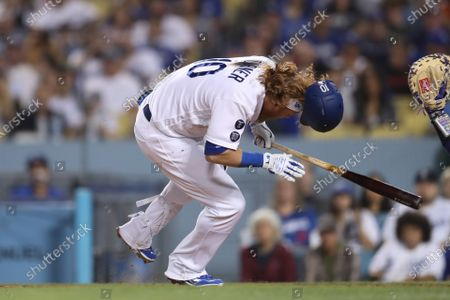 Los Angeles Dodgers third baseman Justin Turner (10) gets hit by a pitch during the game between the Colorado Rockies and the Los Angeles Dodgers at Dodger Stadium in Los Angeles, CA. (Photo by Peter Joneleit)