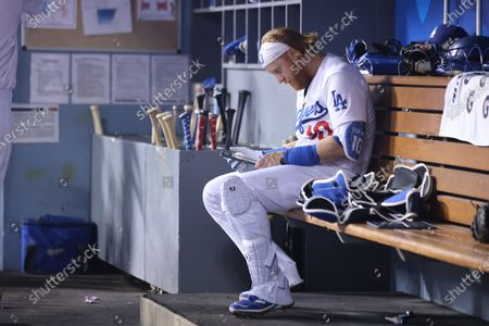 Los Angeles Dodgers third baseman Justin Turner (10) checks his device during the game between the Colorado Rockies and the Los Angeles Dodgers at Dodger Stadium in Los Angeles, CA. (Photo by Peter Joneleit)