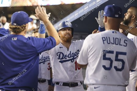 Los Angeles Dodgers third baseman Justin Turner (10) gets high fives in the dugout after his homer during the game between the Colorado Rockies and the Los Angeles Dodgers at Dodger Stadium in Los Angeles, CA. (Photo by Peter Joneleit)