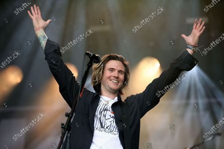 Stock Photo of McFly - Dougie Poynter with his arms up