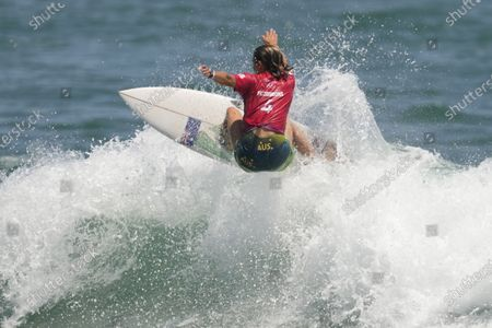 Australia's Sally Fitzgibbons competes during the first round of the women's surfing competition at the 2020 Summer Olympics, at Tsurigasaki beach in Ichinomiya, Japan