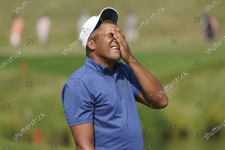 Jhonattan Vegas reacts after missing a putt on the 16th hole during the final round of the 3M Open golf tournament in Blaine, Minn
