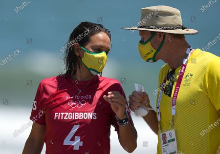 Sally Fitzgibbons from Australia (L) after her Women's Round 1 of the Surfing events of the Tokyo 2020 Olympic Games at the Tsurigasaki Surfing Beach in Ichinomiya, Japan, 25 July 2021.