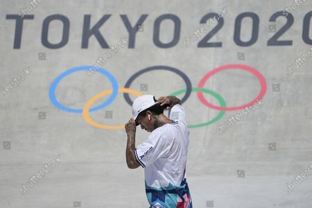 Nyjah Huston of the United States picks himself up after failing to complete his trick in the men's street skateboarding at the 2020 Summer Olympics, in Tokyo, Japan