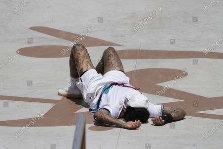 Nyjah Huston of the United States fails to complete his trick in the men's street skateboarding at the 2020 Summer Olympics, in Tokyo, Japan