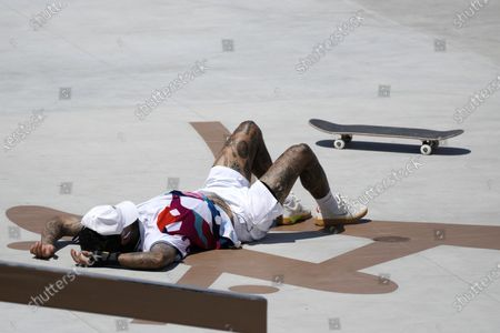 Nyjah Huston of the United States falls during competition in the men's street skateboarding at the 2020 Summer Olympics, in Tokyo, Japan
