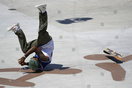 Stock Photo of Manny Santiago of Puerto Rico falls during competition in the men's street skateboarding at the 2020 Summer Olympics, in Tokyo, Japan