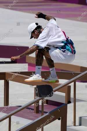 Nyjah Huston of the United States competes in the men's street skateboarding at the 2020 Summer Olympics, in Tokyo, Japan