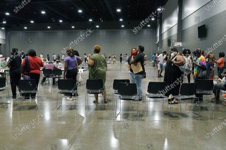 Applicants at a rental assistance fair for Jackson residents at the Mississippi Trademart, line up to be assigned the proper station in the state Fairgrounds, in Jackson, Miss. With the Delta virus variant cases increasing, officials required the applicants to be face masked during the two-day fair to apply for rental assistance through federal financial aid covering 15 months, and utility bill assistance for gas, electricity, water, sewer and trash removal