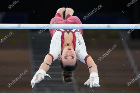 Pauline Schaefer-Betz, of Germany, performs on the uneven bars during the women's artistic gymnastic qualifications at the 2020 Summer Olympics, in Tokyo