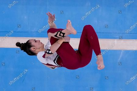 Pauline Schaefer-Betz, of Germany, performs on the beam during women's artistic gymnastic qualifications at the 2020 Summer Olympics, in Tokyo