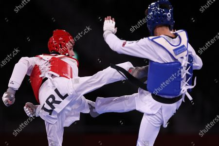 Stock Image of Lucas Lautaro Guzman (ARG) (blue) vs Jack Woolley (IRE) (red) - Taekwondo : Men's -58kg round of 16  during the Tokyo 2020 Olympic Games at the Makuhari Messe Hall B in Chiba, Japan.