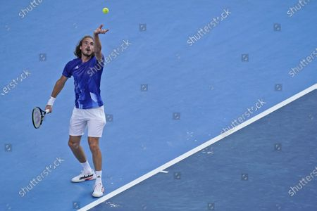 Stefanos Tsitsipas, of Greece, serves to Philipp Kohlschreiber, of Germany, during the first round of the tennis competition at the 2020 Summer Olympics, in Tokyo, Japan