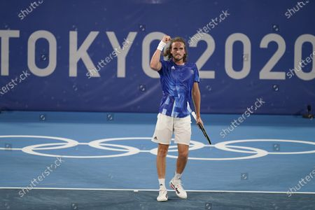 Stefanos Tsitsipas, of Greece, reacts after defeating Philipp Kohlschreiber, of Germany, during the first round of the tennis competition at the 2020 Summer Olympics, in Tokyo, Japan