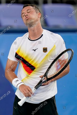 Stock Image of Philipp Kohlschreiber, of Germany, reacts while playing Stefanos Tsitsipas, of Greece, during the first round of the tennis competition at the 2020 Summer Olympics, in Tokyo, Japan