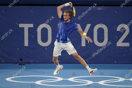 Stefanos Tsitsipas, of Greece, plays Philipp Kohlschreiber, of Germany, during the first round of the tennis competition at the 2020 Summer Olympics, in Tokyo, Japan