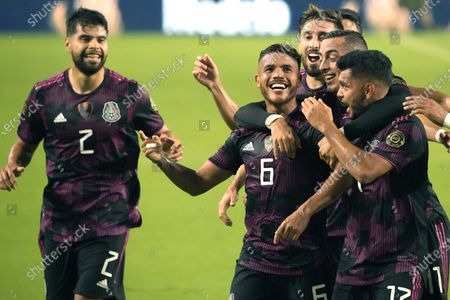 Mexico midfielder Jonathan Dos Santos (6) celebrates with teammates after scoring a goal against Honduras during the first half of a CONCACAF Gold Cup soccer match, in Glendale, Ariz