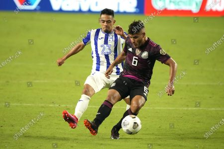Stock Picture of Mexico midfielder Jonathan Dos Santos (6) shields the ball from Honduras defenseman Diego Rodriguez during the second half of a CONCACAF Gold Cup soccer match, in Glendale, Ariz