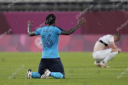 Honduras' Jose Garcia prays after defeating 3-2 New Zealand during a men's soccer match at the 2020 Summer Olympics, in Kashima, Japan