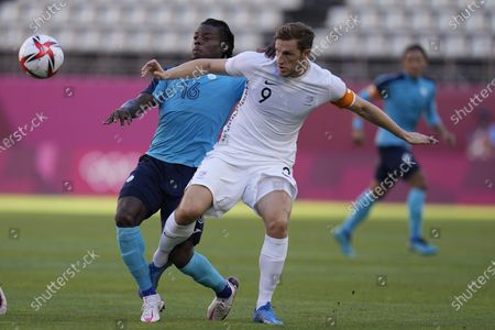 Honduras' Jose Garcia, left, and New Zealand's Chris Wood compete for the ball during a men's soccer match at the 2020 Summer Olympics, in Kashima, Japan