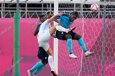 Stock Image of Honduras' Jose Garcia, right, clears the ball challenged by New Zealand's George Stanger during a men's soccer match at the 2020 Summer Olympics, in Kashima, Japan