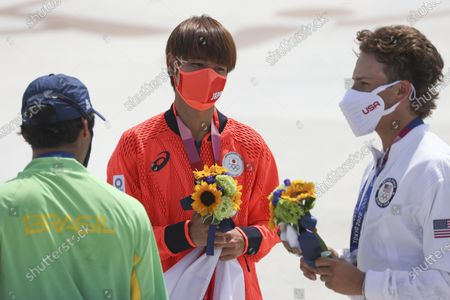 Gold medalist Yuto Horigome (C) of Japan , silver medalist  Kelvin Hoefler (L) of Brazil and bronze medalist Jagger Eaton (R) of USA during medal ceremony after the Skateboarding Men's Street event of the Tokyo 2020 Olympic Games at the Ariake Urban Sports Park in Tokyo, Japan, 25 July 2021.
