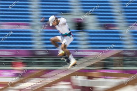A slow shutter camera technic shows Nyjah Huston of USA in action during the Skateboarding Men's Street event of the Tokyo 2020 Olympic Games at the Ariake Urban Sports Park in Tokyo, Japan, 25 July 2021.